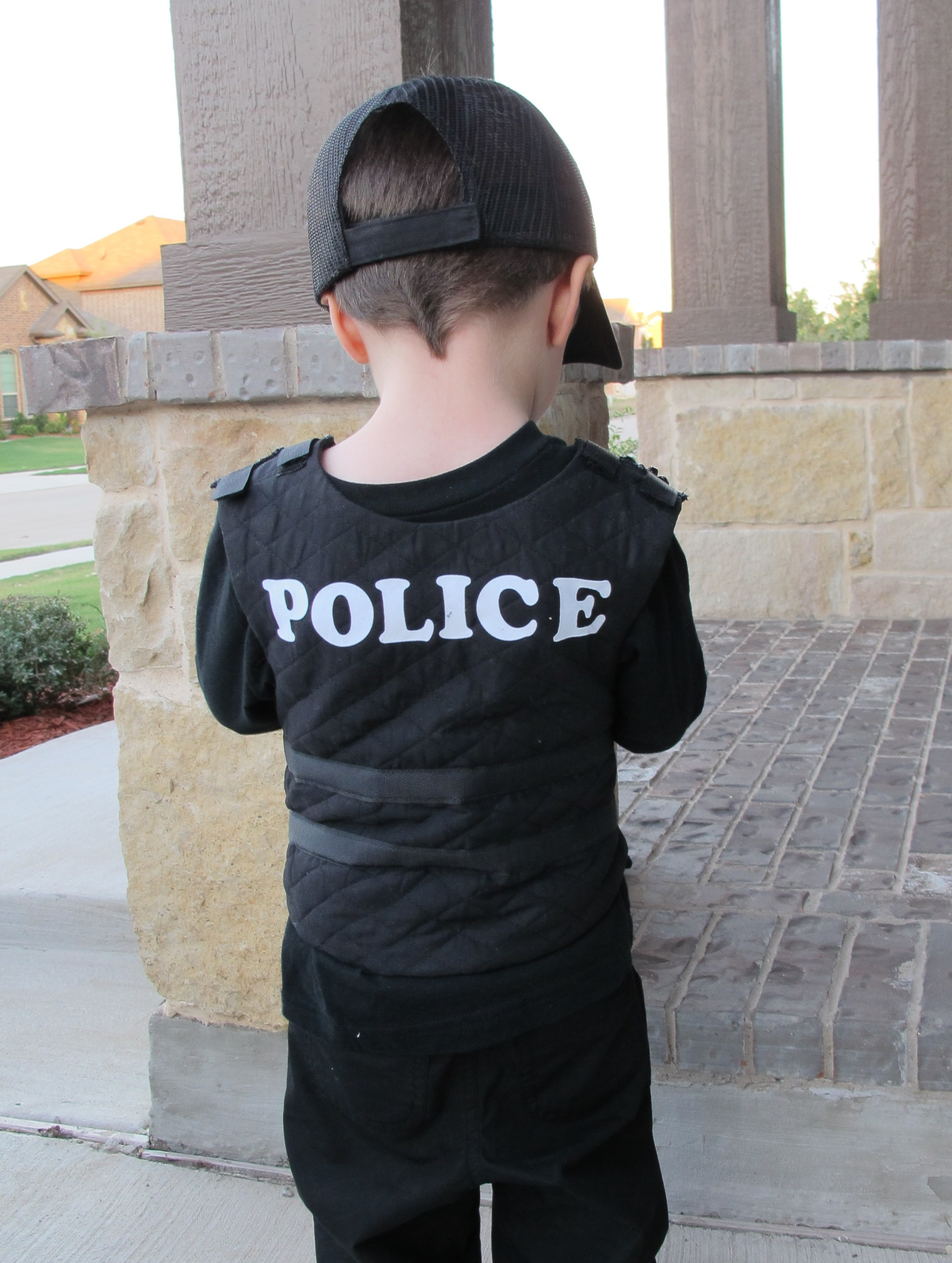 October 2013 operation home she bought a black long sleeved shirt pants and boots then sewed his kevlar vest she added lettering to his vest and hat and added velcro like a real solutioingenieria Image collections